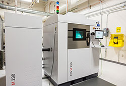 the metal powder bed fusion additive manufacturing system