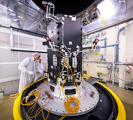 Engineers preparing the developing Solar Probe Plus spacecraft for thermal vacuum tests