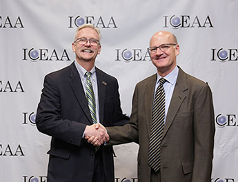A P L's Chuck Alexander with I C E A A International President Paul Marston