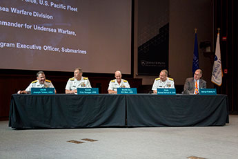 Vice Admiral Joseph Tofalo, Rear Admiral Fritz Roegge, Rear Admiral (Sel) Bill Merz, Rear Admiral Moises Deltoro III, and George Drakeley III participating in a roundtable discussion