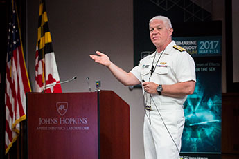 Vice Admiral Terry Benedict delivers the keynote during the conference