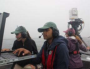 APL FSO operators check the monitors on Sea Hunter as a third operator monitors operations