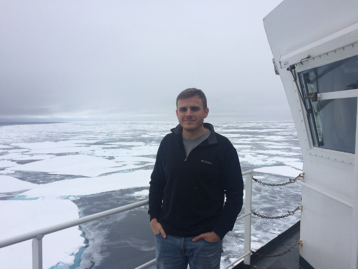 Zachary Burchfield works with a Met UAS in the Arctic