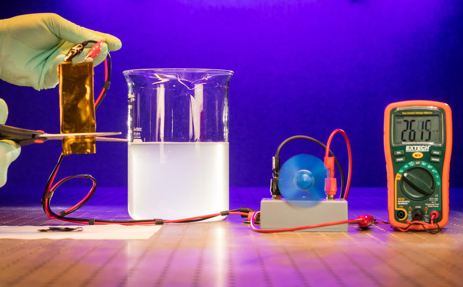 An APL researcher conducts an experiment with a cuttable battery